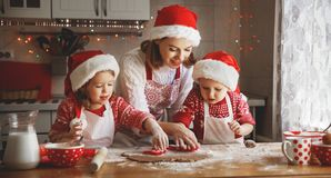 Happy family mother and children  bake cookies for Christmas Stock Photos