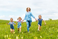 Happy family mother and children daughter girls laughing and run royalty free stock image