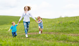 Happy family mother and children daughter and son laughing and r Stock Photo