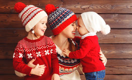 Happy family mother and children girl and boy  hugs at wooden ba Royalty Free Stock Image