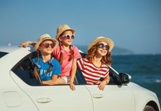 Happy family mother and children girls goes to summer travel trip in car royalty free stock image
