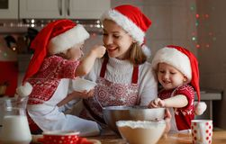 Happy family mother and children  bake cookies for Christmas Stock Images