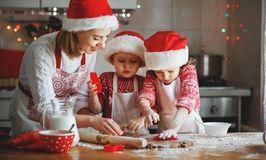 Happy family mother and children  bake cookies for Christmas Stock Photography
