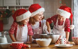 Happy family mother and children  bake cookies for Christmas Royalty Free Stock Images