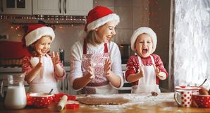 Happy family mother and children  bake cookies for Christmas Royalty Free Stock Image