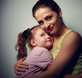Happy family. Mother cuddling daughter with love Royalty Free Stock Photos