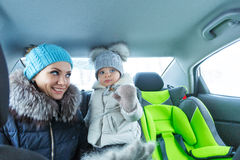 Happy family. Mother and daughter bask in the car Stock Photos