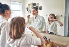 Family are brushing teeth Royalty Free Stock Photos