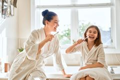 Family are brushing teeth Royalty Free Stock Image