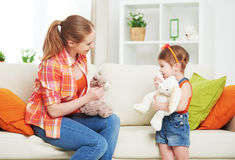 Happy family mother and daughter child girl playing with toy ted Royalty Free Stock Images