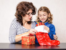 Happy family mother and daughter Christmas present Royalty Free Stock Images