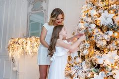 Mother and daughter decorating Christmas tree Stock Images