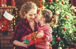 Happy family mother and daughter giving christmas gift Royalty Free Stock Photos
