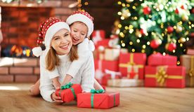 Happy family mother and daughter giving christmas gift Stock Photography