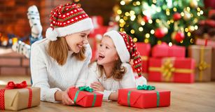 Happy family mother and daughter giving christmas gift Royalty Free Stock Images