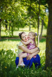 Happy family. Mother and  daughter lie on a grass I embrace  in Stock Images
