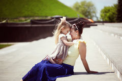Happy family. Mother and the daughter look at each other, smile, Stock Photography