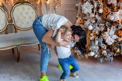Mother and daughter near a Christmas tree Stock Images