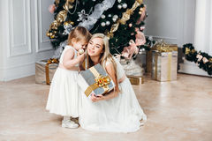 Happy family mother and daughter at  New Year with Royalty Free Stock Image
