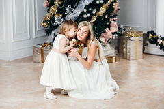 Happy family mother and daughter at  New Year with Royalty Free Stock Images