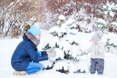 Happy family. Mother and daughter playing in winter Royalty Free Stock Photos