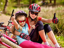 Happy family. Mother and daughter are on road near bicycles. Royalty Free Stock Photography
