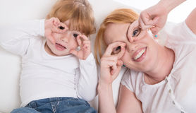 Happy family: mother and daughter on white background having fun stock image