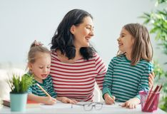 Mother and daughters drawing together royalty free stock photos