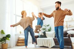 Free Happy Family Mother Father And Child Daughter Dancing At Home Stock Photos - 144230193