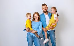 Free Happy Family Mother Father And Children Daughter And Son  Near An   Grey Blank Wall Stock Image - 161136291