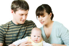 Happy family - mother, father and baby Stock Photography