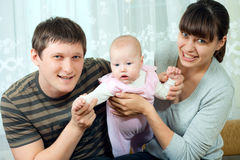 Happy family - mother, father and baby Royalty Free Stock Photography