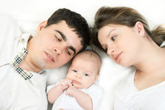 Happy family - mother, father and baby Stock Photo