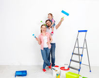 Happy family mother father and baby daughter are doing repairs p Royalty Free Stock Image