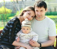 Happy family. Mother, father and baby girl Stock Photo