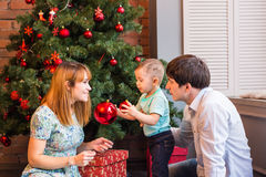 Happy family mother, father and baby little child playing in the winter for the Christmas holidays Royalty Free Stock Images