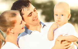 Happy family mother, father, baby in summer nature royalty free stock photo