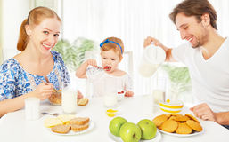 Happy family mother, father, child baby daughter having breakfas Royalty Free Stock Photos