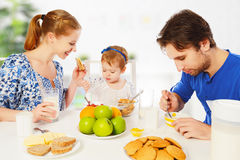Happy family mother, father, child baby daughter having breakfas Royalty Free Stock Images