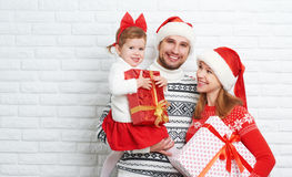 Happy family mother, father and child at Christmas Stock Image