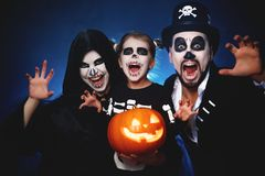 Happy family mother father and child in costumes and makeup on Stock Photos