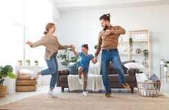 Happy family mother father and child daughter dancing at home royalty free stock photos