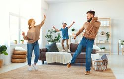Happy family mother father and child daughter dancing at home royalty free stock photo