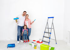 Happy family mother father and child daughter are doing repairs Royalty Free Stock Images