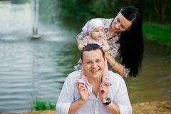 Happy family mother, father, child daughter stock photography