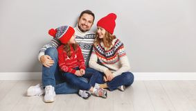 Happy family mother, father and child daughter in knitted hats a stock photos