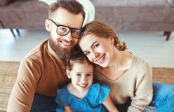 Happy family mother father and child daughter laughing   at home stock photo