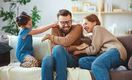 Happy family mother father and child daughter laughing   at home stock photos