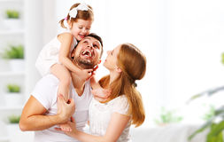 Happy family mother, father, child at home. Happy family mother, father, child daughter at home royalty free stock photo