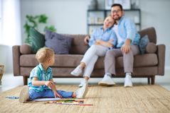 Happy family mother father and child son draw together at home royalty free stock photos